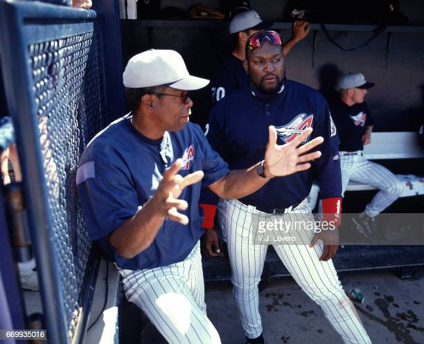 Anaheim Angels hitting coach Rod Carew talking with Mo Vaughn in dugout during spring training game at Tempe Diablo Stadium Tempe AZ J Lovero