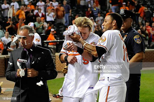 ESPN baseball analyst Tim Kurkjian gets hit with the majority of the shaving cream pie that Robert Andino meant for Nate McLouth of the Baltimore...