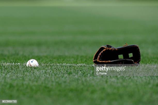 A baseball and glove on the field before the game between the Washington Nationals and the Cincinnati Reds at Nationals Park on June 23 2017 in...