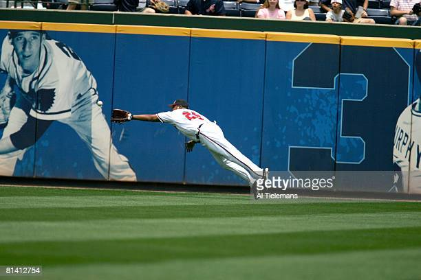 Baseball Atlanta Braves Andruw Jones in action fielding and making diving catch vs Baltimore Orioles Atlanta GA 6/25/2005