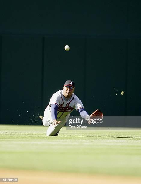 Baseball Atlanta Braves Andruw Jones in action fielding and making diving catch vs Philadelphia Phillies Philadelphia PA 4/16/2005