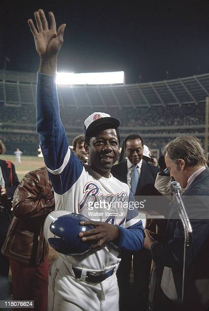 Atlanta Braves Hank Aaron victorious after hitting 715th career home run and breaking Babe Ruth's record during game vs Los Angeles Dodgers at...