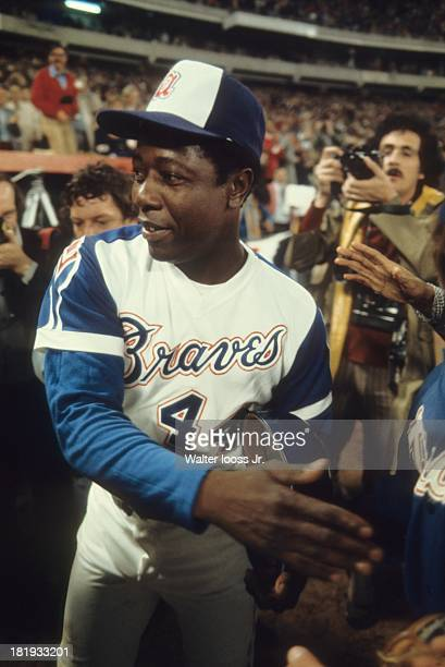 Atlanta Braves Hank Aaron victorious after receiving home run ball back from Tom House during game vs Los Angeles Dodgers at Atlanta Stadium Hank...
