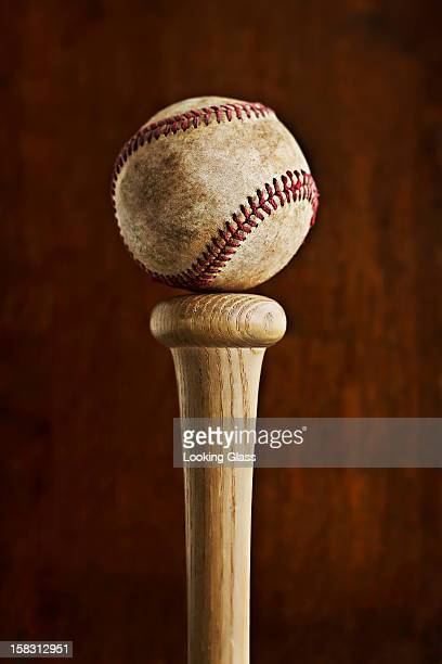 baseball balancing on baseball bat - baseball bat stock pictures, royalty-free photos & images