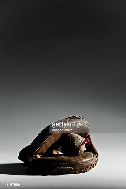 baseball ball in glove - baseball glove stock pictures, royalty-free photos & images