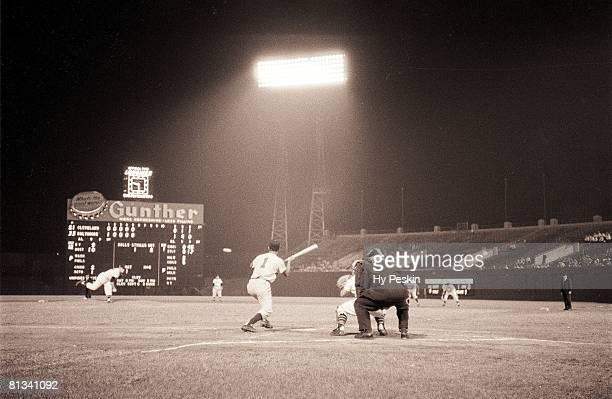 Baseball Baltimore Orioles Chico Garcia in action making bunt vs Cleveland Indians Bob Lemon View of Memorial Stadium Baltimore MD 8/21/1954