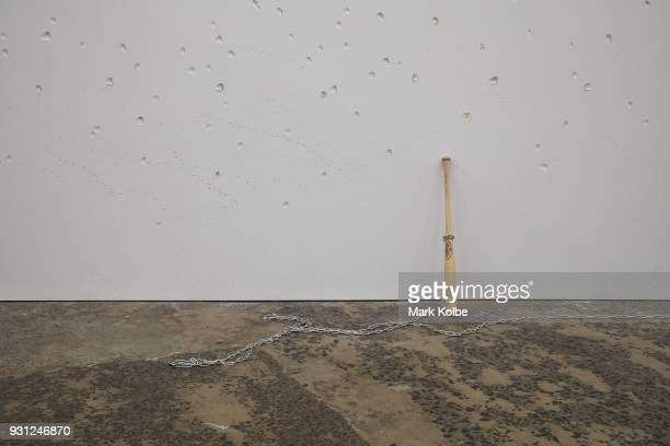 A baseball bat leans against the wall as part of the artwork 'Constellations' by artist Marco Fusinato which is part of the 31st Biennale of Sydney...