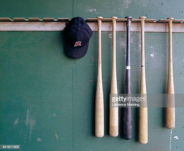 baseball bats and hat hanging - baseball bat stock pictures, royalty-free photos & images