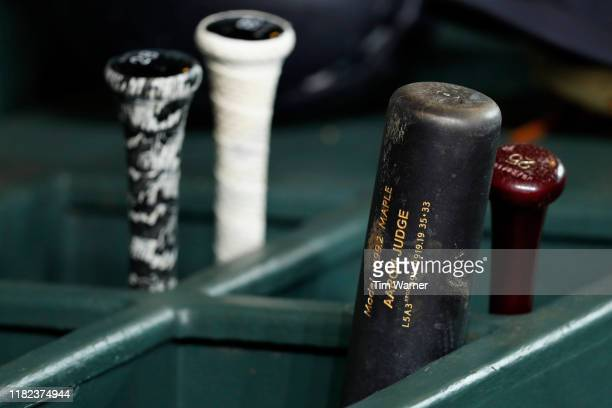 Baseball bats are seen in the New York Yankees dugout during Game Six of the League Championship Series at Minute Maid Park on October 19 2019 in...