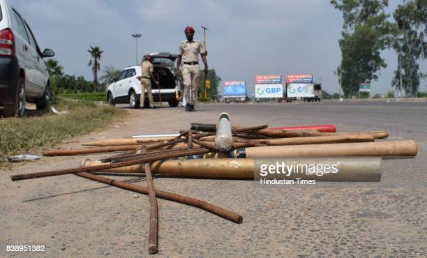 Baseball bats hockey sticks and iron rods recovered by cops during checking the vehicles at a naka at intersection of Airport road and Patiala road...