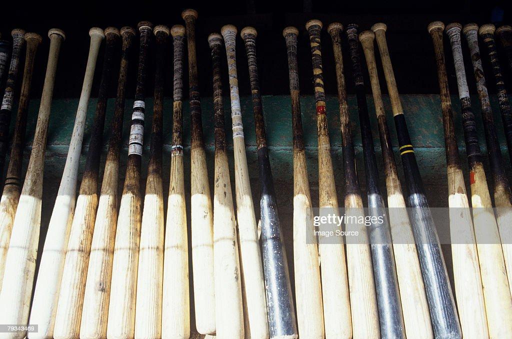 Baseball bats in a row : Stock Photo