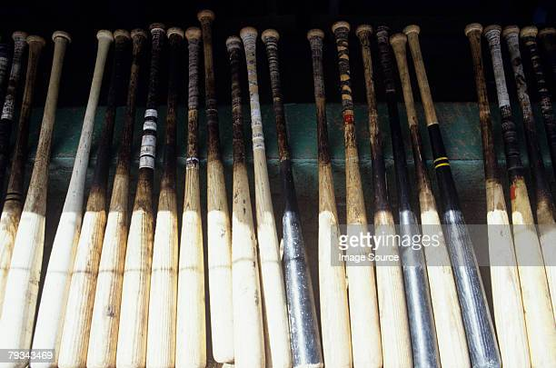 baseball bats in a row - baseball bat stock pictures, royalty-free photos & images