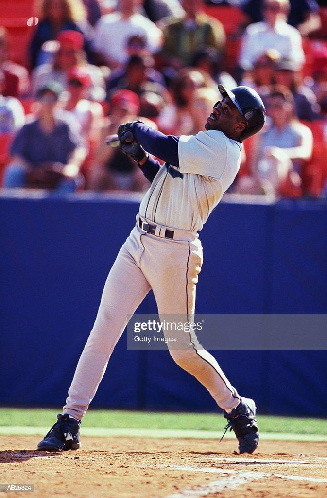 Baseball batter hitting pitch : Stock Photo