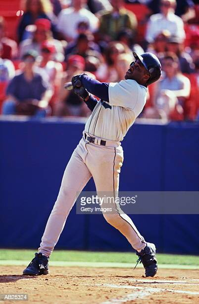 Baseball batter hitting pitch