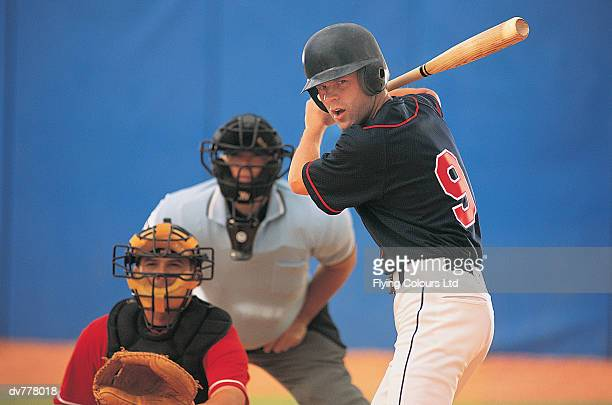 baseball batter in front of baseball catcher and umpire - baseball catcher stock pictures, royalty-free photos & images
