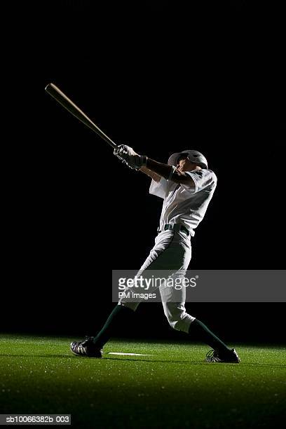 baseball batter swinging bat, side view - batting stock pictures, royalty-free photos & images