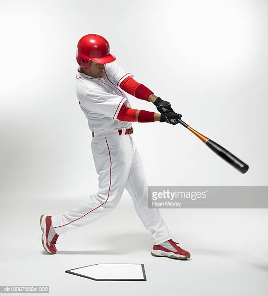 baseball batter swinging, studio shot - baseball player stock pictures, royalty-free photos & images