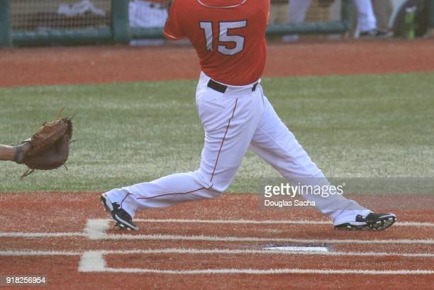 baseball batter swings at the pitch - baseball pitcher stock pictures, royalty-free photos & images