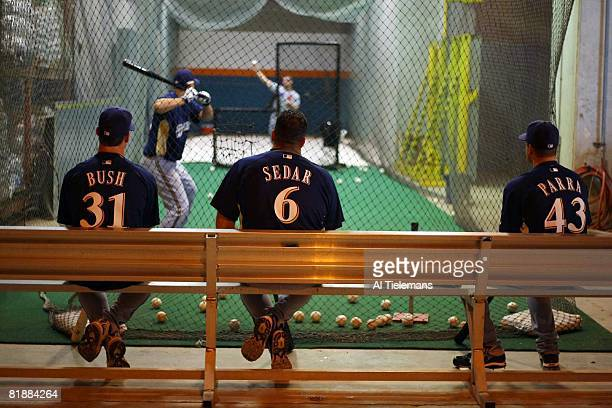 Baseball Behind the Scenes Milwaukee Brewers Carlos Villanueva taking batting practice in indoor cage as Dave Bush first base coach Ed Sedar and...