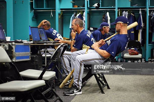 Baseball Behind the Scenes Milwaukee Brewers pitching coach Mike Maddux and Jason Kendall go over game plan in clubhouse locker room before game vs...