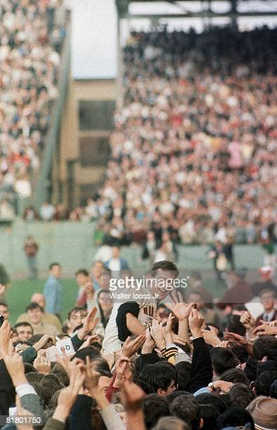 Baseball Boston Red Sox Jim Lonborg victorious getting carried by fans after winning with complete game and clinching NL pennant vs Minnesota Twins...