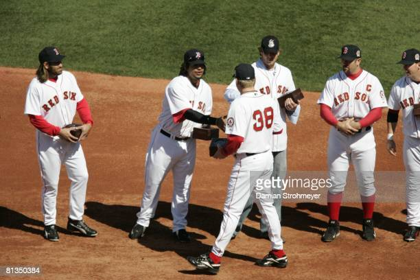 Baseball Boston Red Sox Manny Ramirez victorious with Curt Schilling and World Series rings during award ceremony before home opening day game vs New...