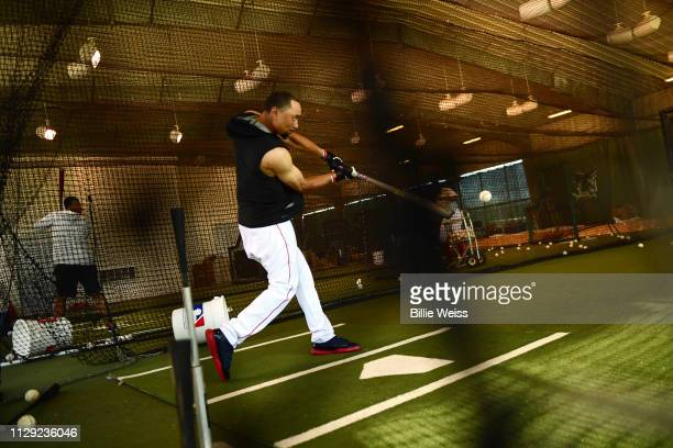 Boston Red Sox Mookie Betts hitting in batting cage during spring training photo shoot at JetBlue Park Behind the Scenes Fort Myers FL CREDIT Billie...