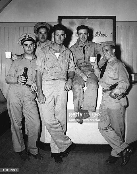 Date Unknown MLB Baseball Boston Red Sox outfielder Ted Williams with some of his Navy and Marine flying comrades at a coffee bar at the Pensacola...