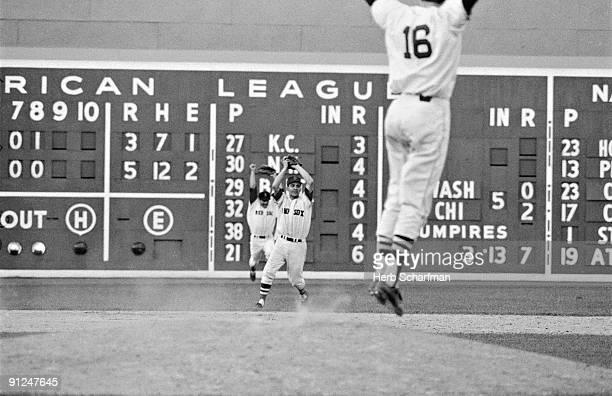 Boston Red Sox Rico Petrocelli Carl Yastrzemski and Jim Lonborg victorious after winning game vs Minnesota Twins and clinching AL pennant Boston MA...