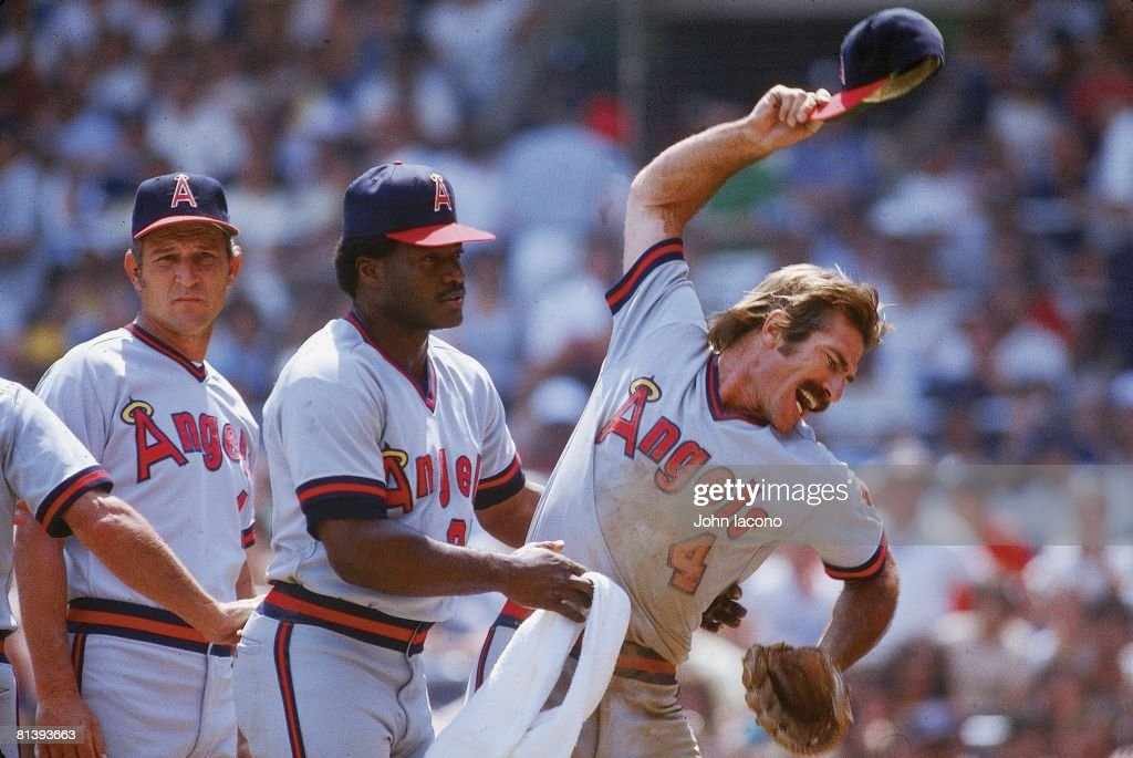 California Angels Bobby Grich (4) upset, getting restrained by Don Baylor (25) after getting ejected from game vs New York Yankees, Bronx, NY 7/25/1982
