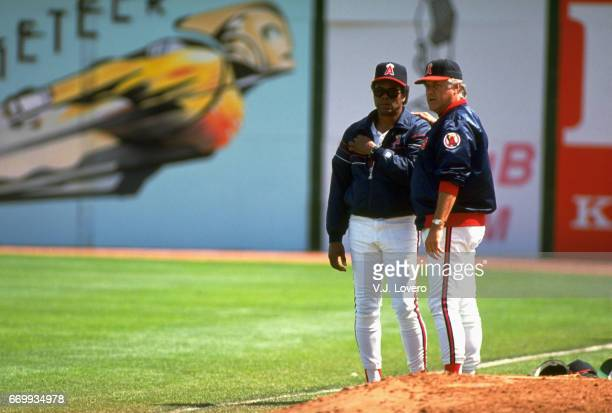 California Angels manager Buck Rodgers with hitting coach Rod Carew during spring training at Palm Springs Stadium Palm Springs CA J Lovero