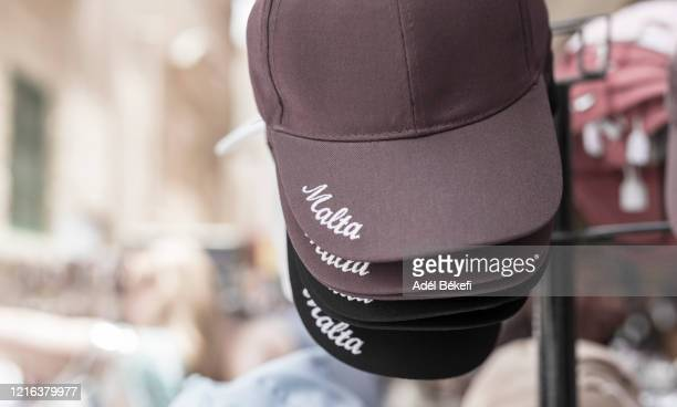 baseball cap for sale at street stall (malta) - gift shop stock pictures, royalty-free photos & images
