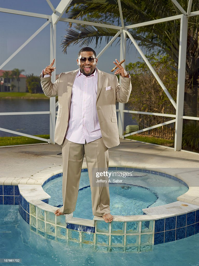 Casual portrait of San Francisco Giants third baseman Pablo Sandoval posing during photo shoot on his pool at home. Jeffery A. Salter F1 )
