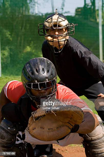 A baseball catcher and an umpire at a game