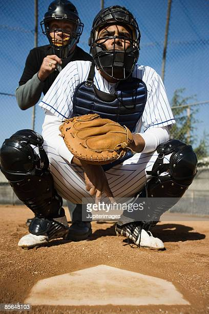 baseball catcher and umpire behind home plate - キャッチャー ストックフォトと画像