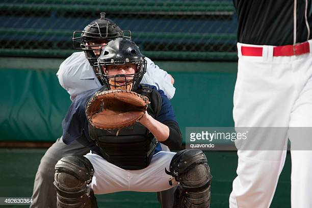 baseball catcher anticipating pitch - baseball catcher stock photos and pictures