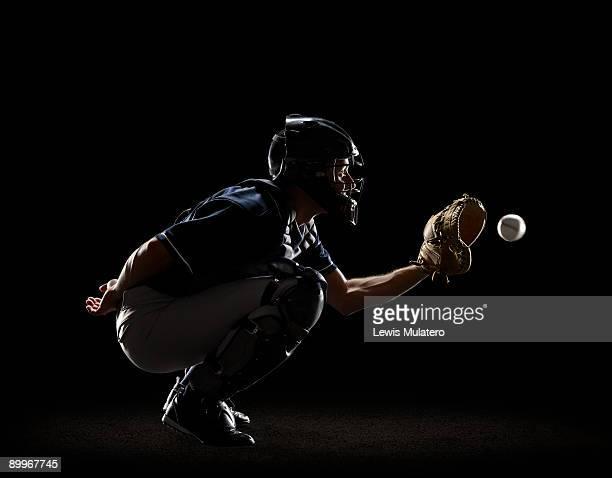 Baseball Catcher catching ball in mitt