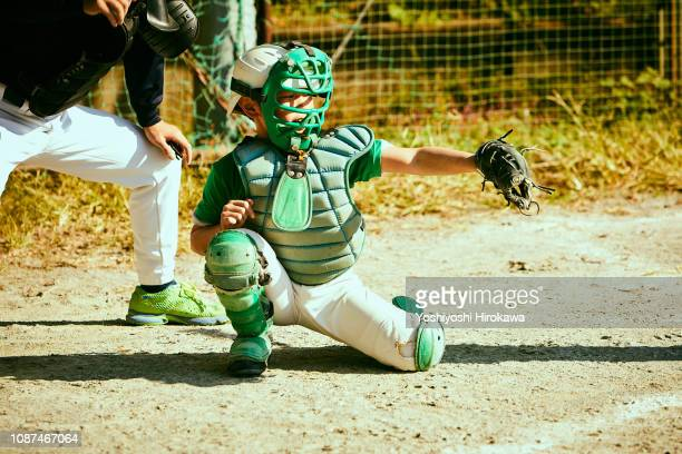 baseball catcher fielding ball.and his father umpire at sunday. - キャッチャー ストックフォトと画像