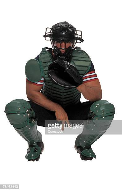 baseball catcher giving hand signals - baseball catcher stock photos and pictures
