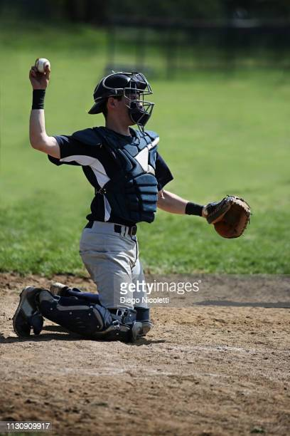 baseball catcher in throwing stance - baseball catcher stock pictures, royalty-free photos & images
