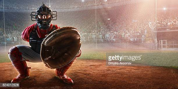 baseball catcher on stadium - baseball catcher stock pictures, royalty-free photos & images