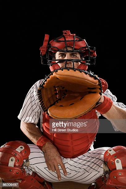 baseball catcher signaling - baseball catcher stock photos and pictures