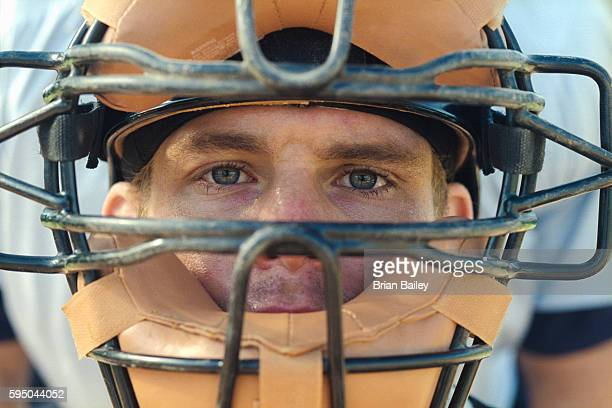 baseball catcher wearing mask - baseball catcher stock photos and pictures