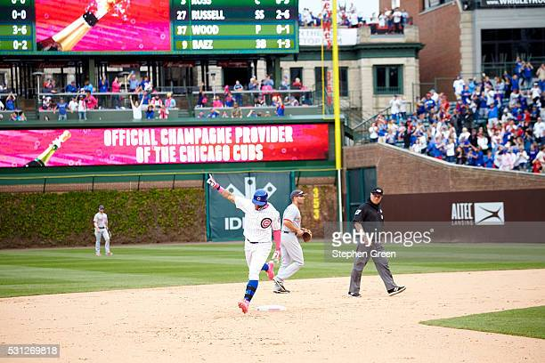 Chicago Cubs Javier Baez in action running bases after hitting game winning home run victorious vs Washington Nationals at Wrigley Field Baez hits...