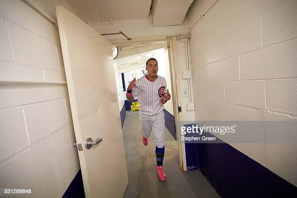 Chicago Cubs Javier Baez victorious running through tunnel after hitting game winning home run vs Washington Nationals at Wrigley Field Chicago IL...