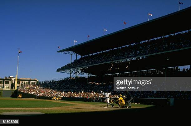 Baseball Chicago Cubs Leon Durham in action at bat vs Pittsburgh Pirates View of Wrigley Field stadium Chicago IL 9/20/1984
