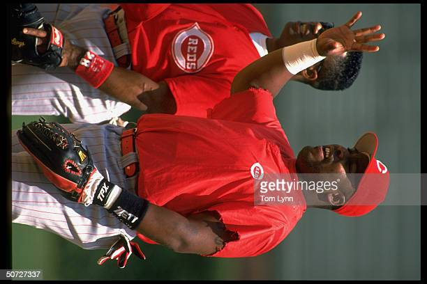Cin Reds Kevin Mitchell w Lenny Harris in outfield during BP before game