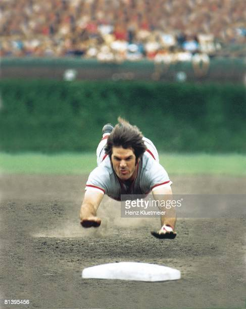 Baseball Cincinnati Reds Pete Rose in action diving into third base during slide vs Chicago Cubs Chicago IL 8/29/1975
