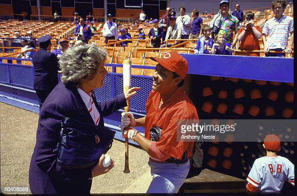 Cinn Reds owner Marge Schott on field talking w Tony Perez before game vs NY Mets