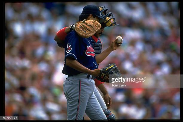 Cleveland Indians Tony Pena w arm around Dennis Martinez during game